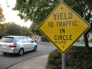 "Sign saying ""Yield to Traffic in Circle of Life"""